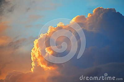 Blue sky with gold cloud