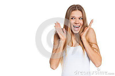 Surprised happy young woman looking sideways in excitement. Isolated over white