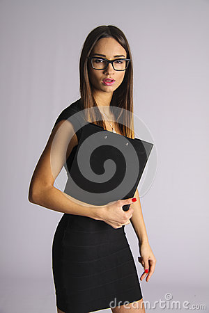 Latin business woman holding clipboard with thinking expression