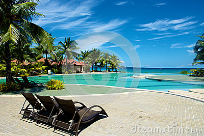 Swimming pool vacation resort with recliner in Boracay