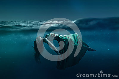 Woman floating under water