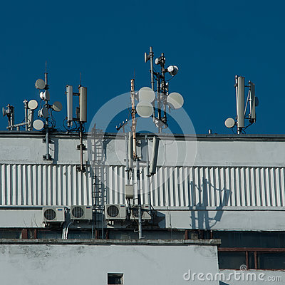 Many antennas on city building. Antennes GSM 3G CDMA UMTS.