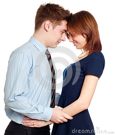 Embracing young couple in love, happy smiling, isolated on white