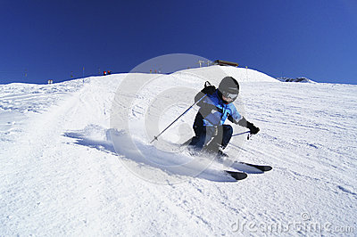 Young boy performing carved ski turn