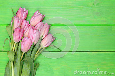 Tulips flowers bouquet in spring or mother's day on wooden board