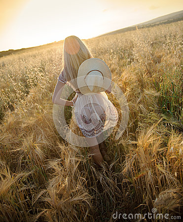 A beautiful woman in golden hay field 6