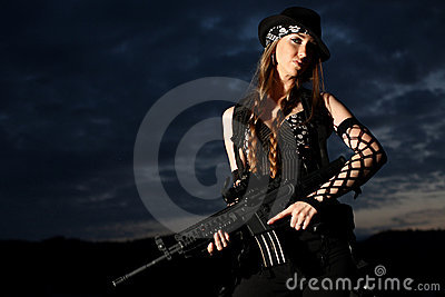 Stylish young woman with gun