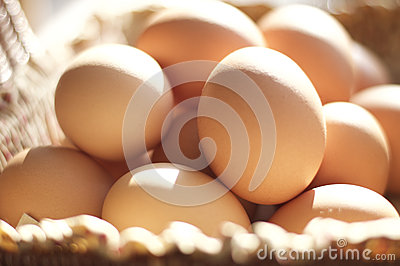 Brown eggs in a brown basket