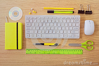 Office desk template with keyboard and office items. View from above