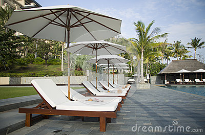 Umbrellas and loungers by the pool