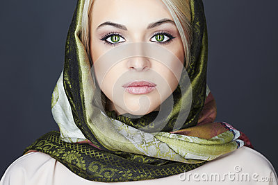 Beautiful blond woman in scarf.winter fashion.Beauty Girl.Classic Russian style.close-up make-up