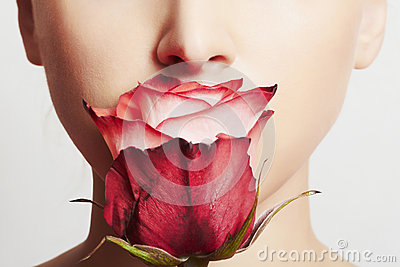 Beautiful blond woman face and flower.girl and rose.skin care