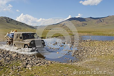Mongolian people relocate nomadic tent by car in Kharkhorin, Mongolia.