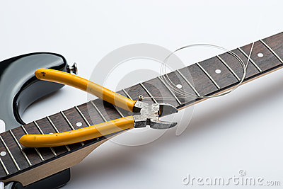 Electric guitar frets with string and yellow nippers