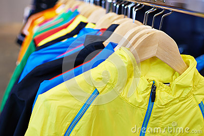 Sportswear on hangers in store