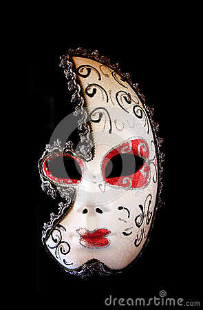 Dramatic and mysterious half moon carnival mask isolated on black