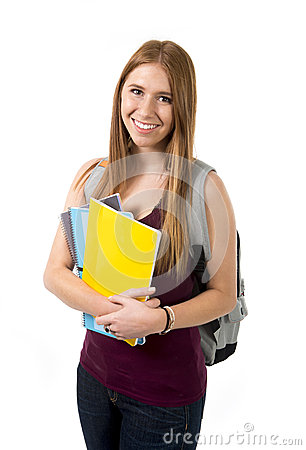 Young beautiful college student girl carrying backpack and books posing happy and confident in university education concept