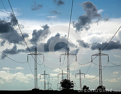 Pillars of line power electricity on background blue sky