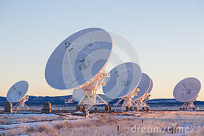 Satellite dishes in a field