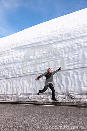 Highway along the snow wall. Norway in spring