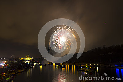 Amazing exploding yellow firework celebration of the new year 2015 in Prague with the historic city in the background