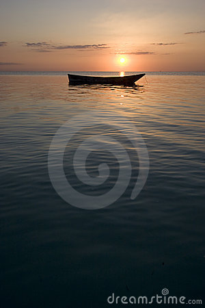 Portrait shot of row boat at sunset in africa zanz