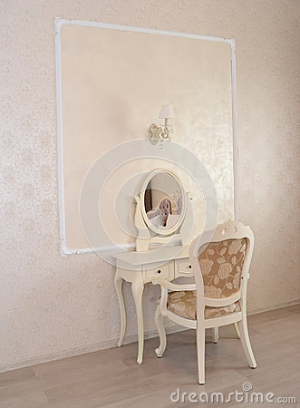 Dressing table and white chair in a hotel room