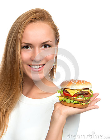 Woman hold tasty unhealthy burger sandwich with cheese