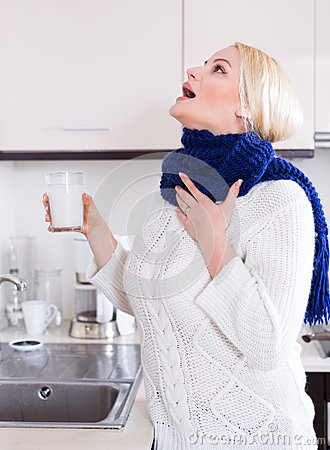 Woman standing with gargle solution