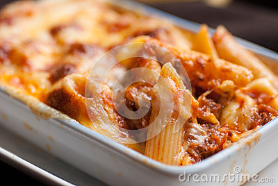 Baked penne pasta with tomato sauce and cheese