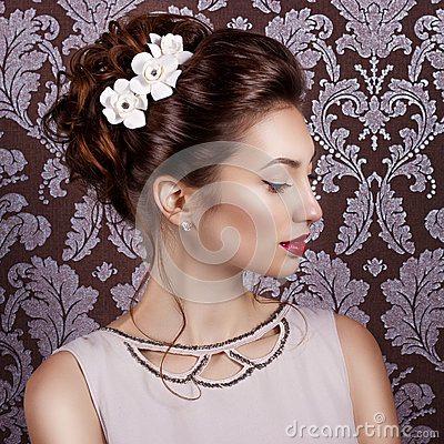 Beautiful young sweet girl with large red lips in wedding white wreath on the head