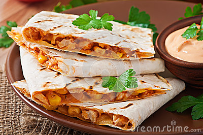 Mexican Quesadilla sliced with vegetables