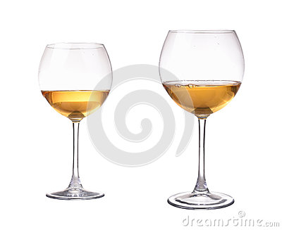 Two different size wineglass with white wine. Concept and idea