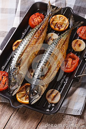 Grilled sea fish and vegetables in a pan grill, vertical top vie