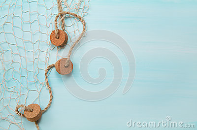 Maritime nautical blue and turquoise wooden background with a fi