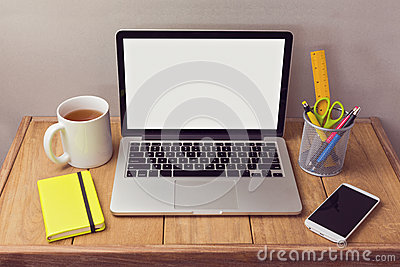 Office desk mock up with laptop and office items