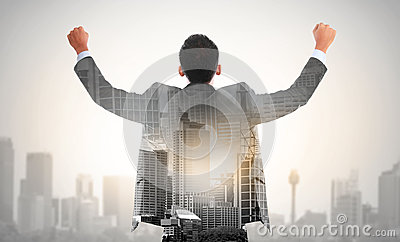 Success business man raise his hand double exposure concept