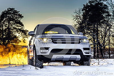 Powerful offroader car view on winter background