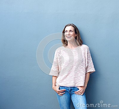 Confident relaxed trendy middle aged woman smiling