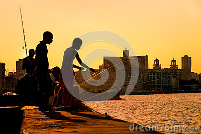 Young boys fishing at sunset in Havana