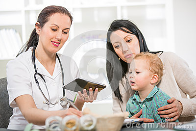 Young woman and her child at the doctor homeopaths