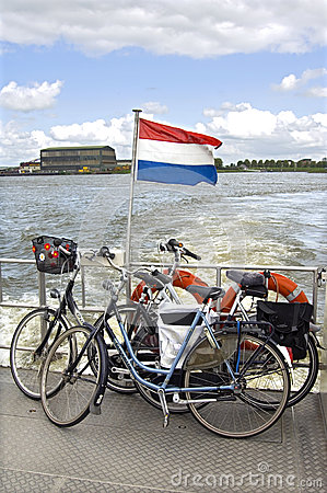 stock image of transport of bicycles across the river, netherlands