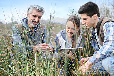 Rofessor with agronomy students outdoors