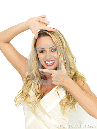 Happy Young Woman Posing By Framing Her Face With Her Hands