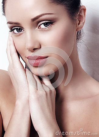 Woman with dark hair with natural makeup and radiance health skin posing