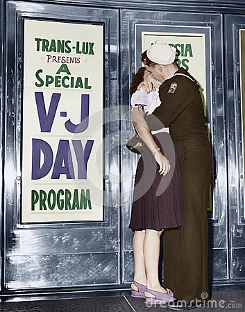 U.S. sailor and his girlfriend celebrate news of the end of war with Japan in front of the Trans-Lux Theatre in New York's Time Sq