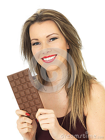 Young Woman Holding a Milk Chocolate Bar