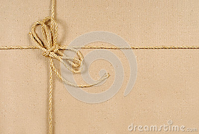 Brown paper or cardboard background with string