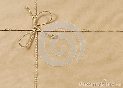 Brown paper parcel or package background with rope or string, copy space, horizontal