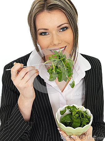 Young Business Woman Eating a Fresh Green Leaf Salad